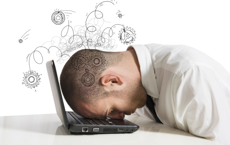 Concept of stress with businessman sleeping on a laptop